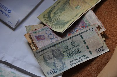 Money from RTW family travel. Different amounts of paper currency from Paraguay.