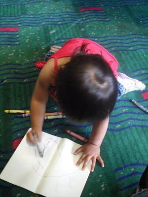 A child coloring during an airport layover with kids
