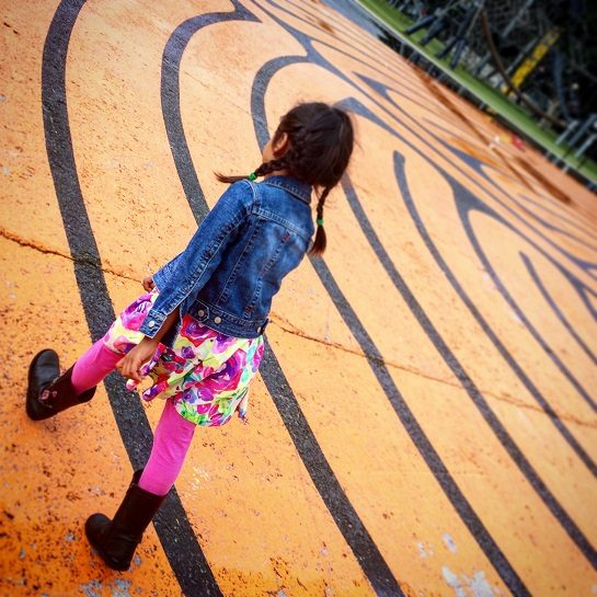 girl walking in labyrinth