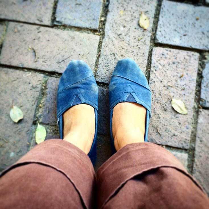 Feet in Tom's shoes in South Africa, showcasing privilege in travel