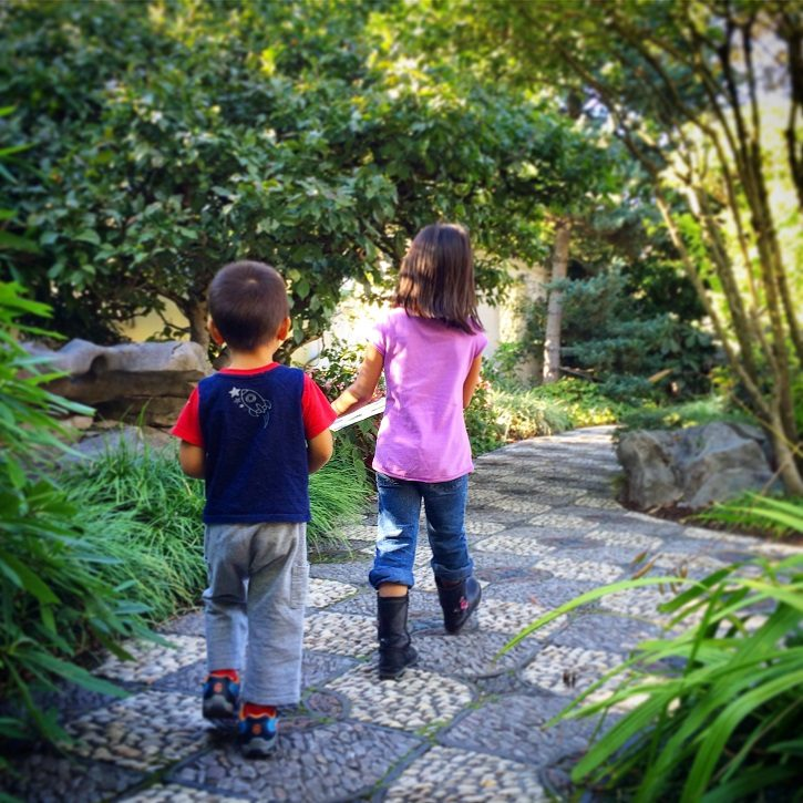 Kids exploring a garden in kid friendly Portland