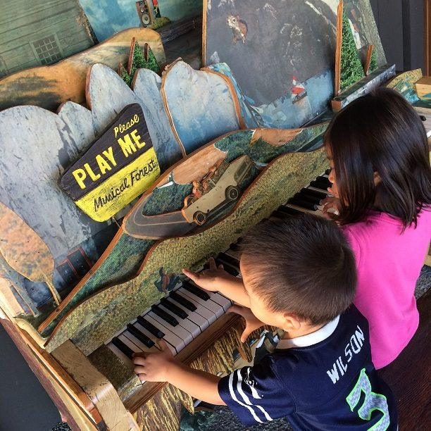 Kids playing piano in kid friendly Portland, Oregon