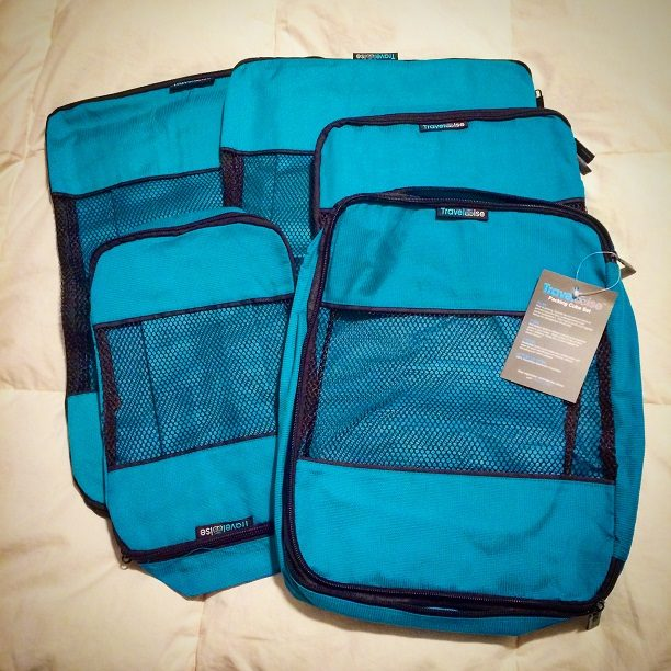 Various sized empty packing cubes for family travel