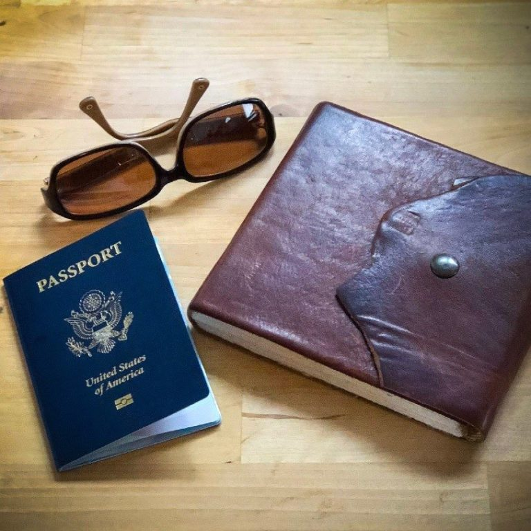 passport, journal, and sunglasses