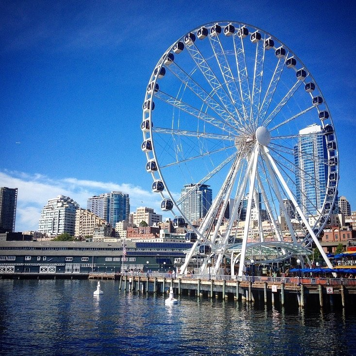 The Great Wheel, a large ferris wheel in downtown Seattle, where families like to visit during a staycation with kids