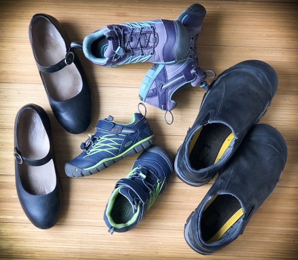 Shoes are essential travel items for family travel