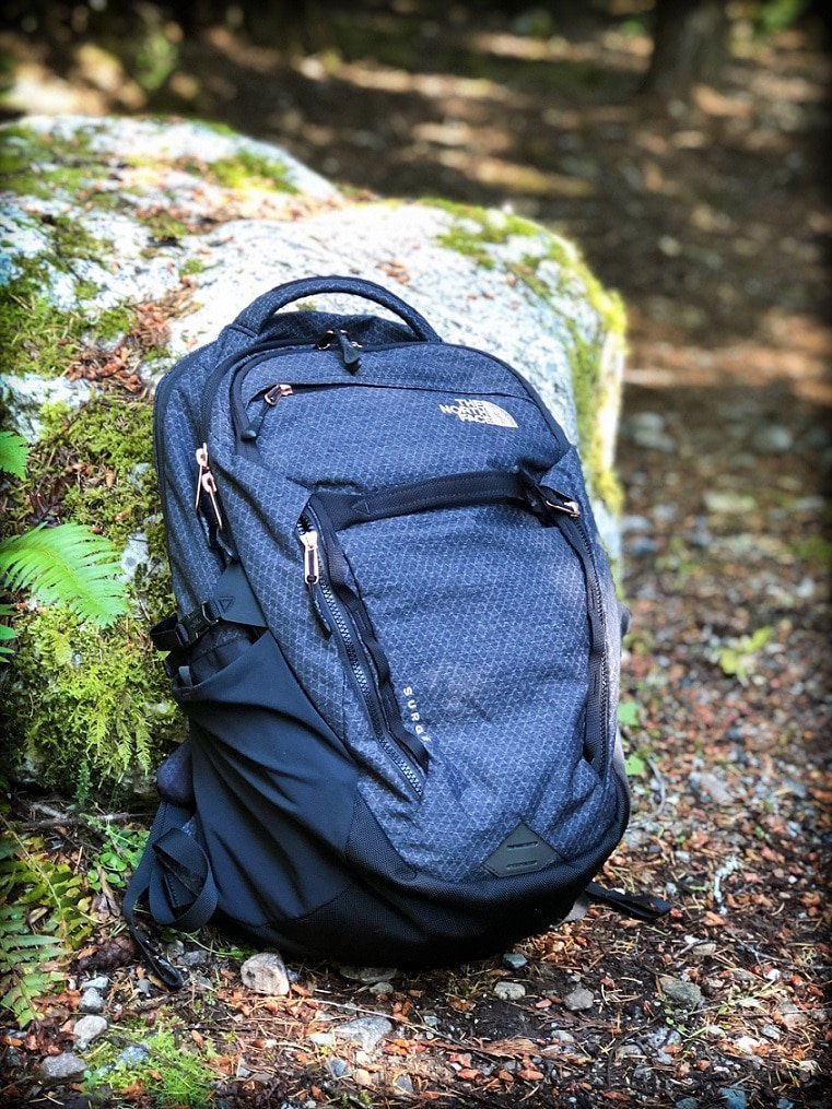 A backpack against a boulder