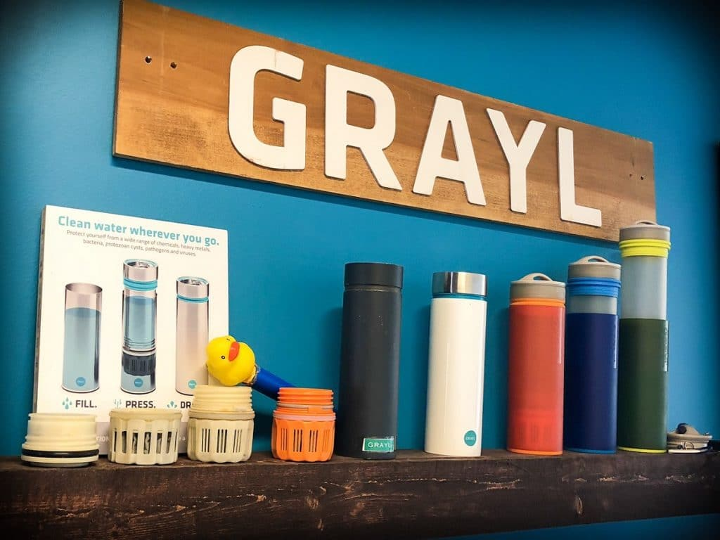 A shelf of GRAYL water bottles, family camping essentials for clean water