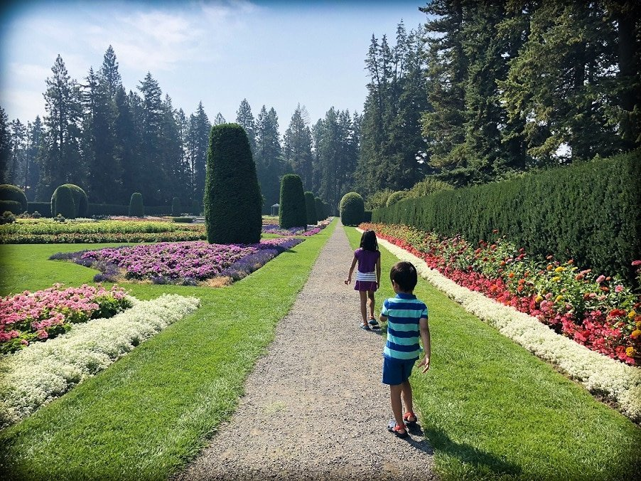 Kids walking through Manito Park in Spokane, a destination for Seattle day trips
