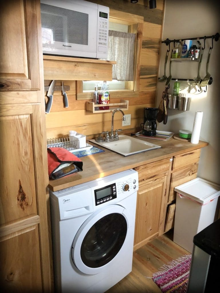 A tiny house kitchen at an Airbnb, an option for families when budgeting for a road trip