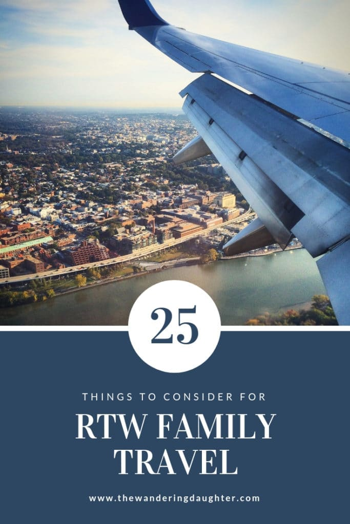 Pinterest Image for blog post: 25 Things To Consider For RTW Family Travel. An image of the wing of a plane, overlooking a city and a river.
