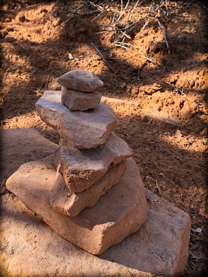 Stone stacks in the shade, seen on a hike at Arches National Park with kids
