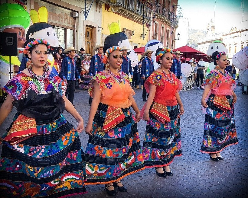 Dancers in Guanajuato, Mexico, where families can visit while traveling to Mexico with kids