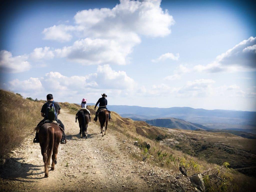A family horseback riding in Mexico