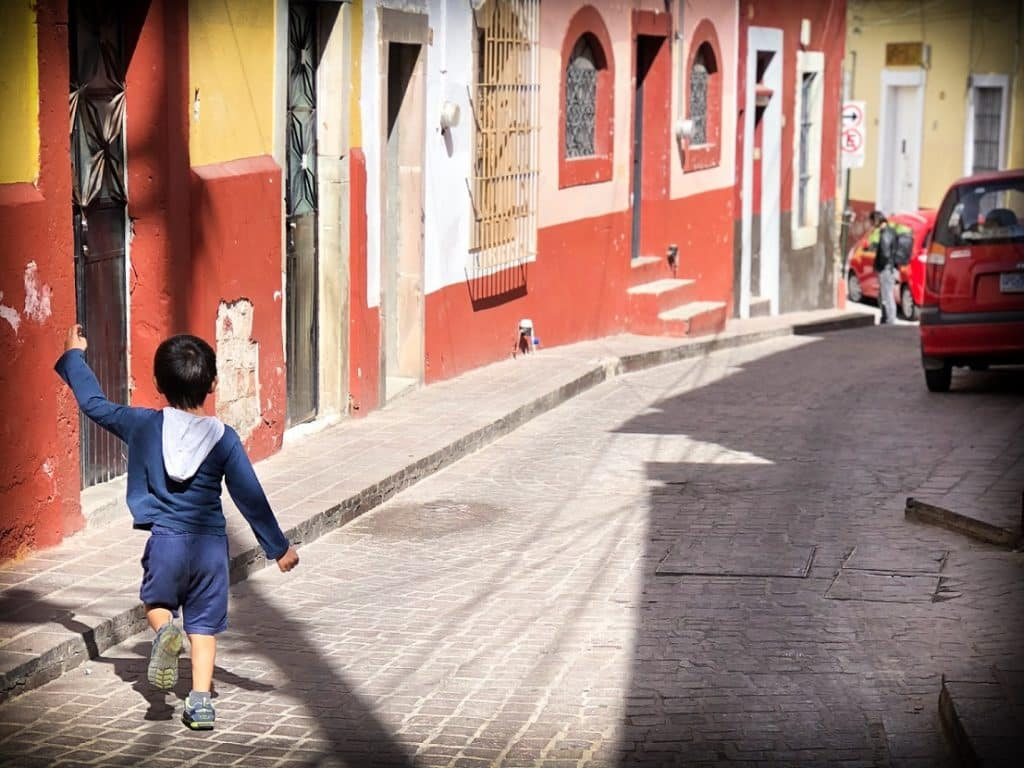 A child doing travel fitness by walking in an alley