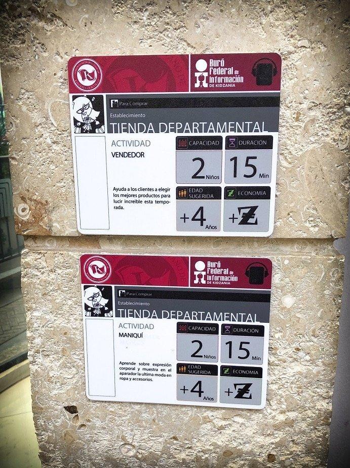 Informational signs in front of KidZania activities