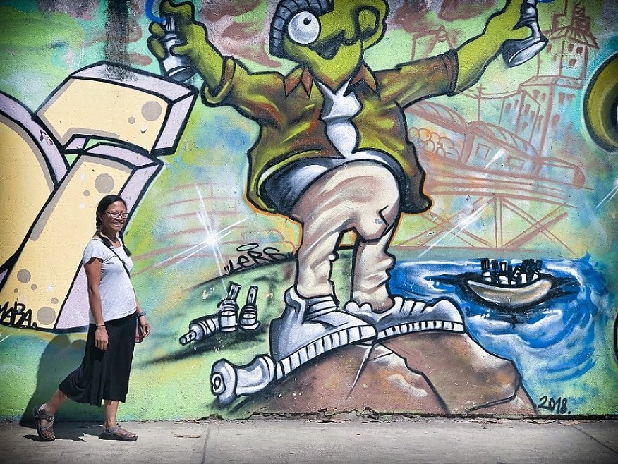 A digital nomad with family exploring street art in Puerto Escondido, Mexico