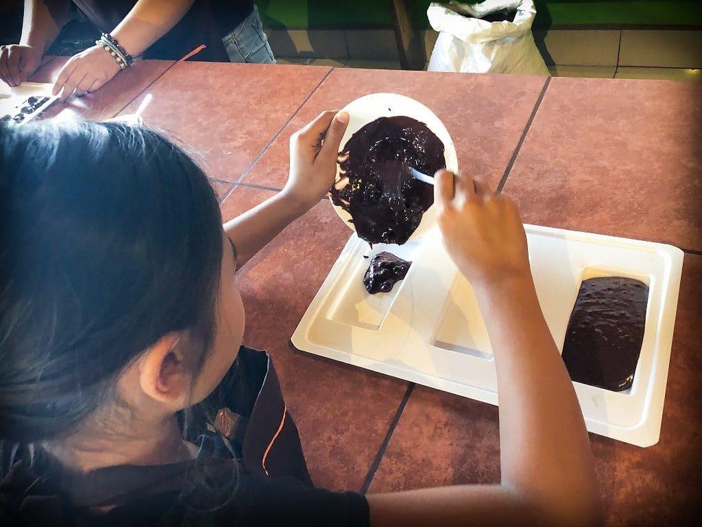 Girl making chocolate bars as part of homeschool activities