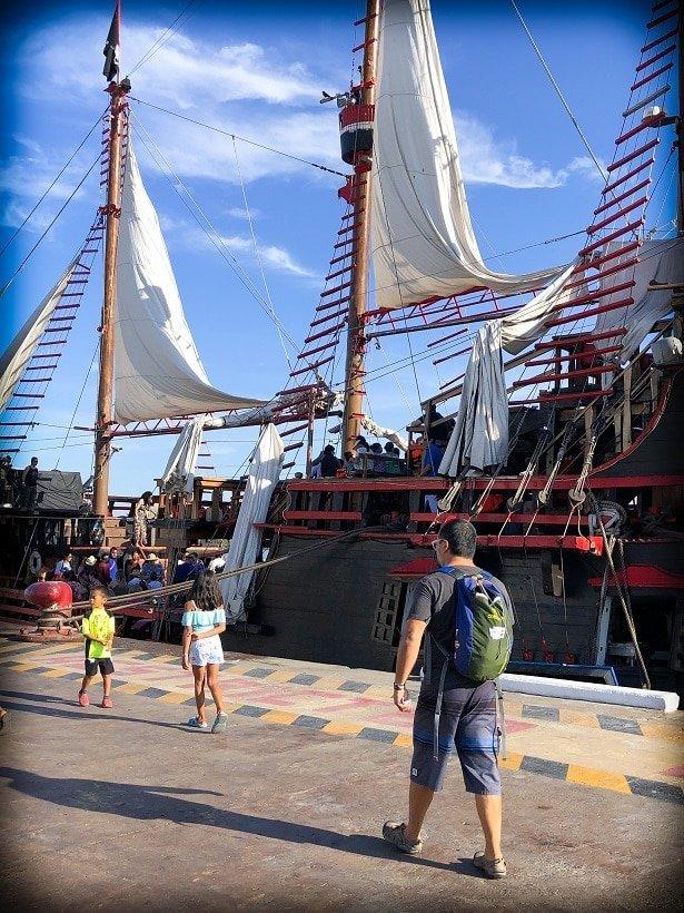 A family walking onto a Puerto Vallarta pirate ship