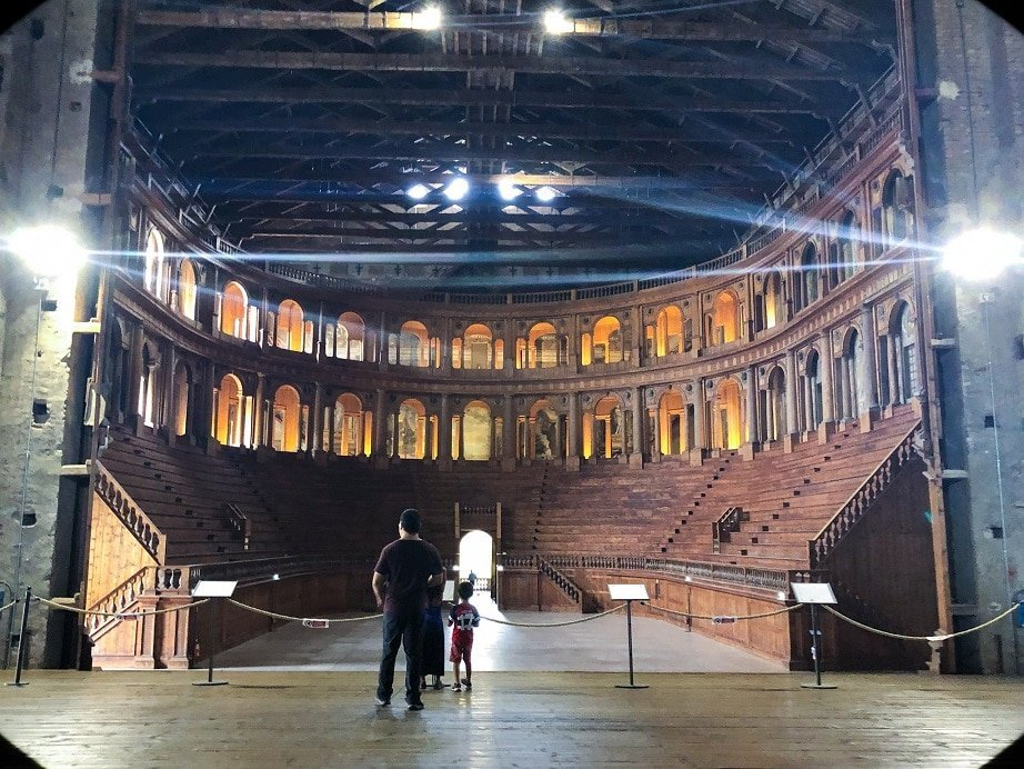 A man and boy visiting Teatro Farnese in Parma, Italy, an example of what to do in Parma