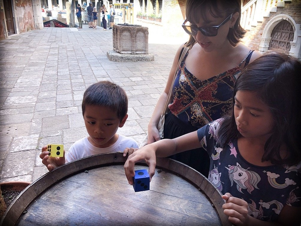 Kids and a tour guide doing game during a family-friendly Venice walking tour
