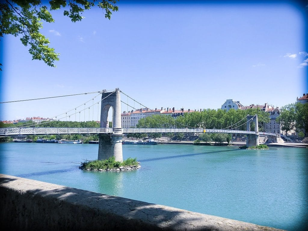 A stone pedestrian bridge in Lyon, France, traversing one of the rivers in Lyon.