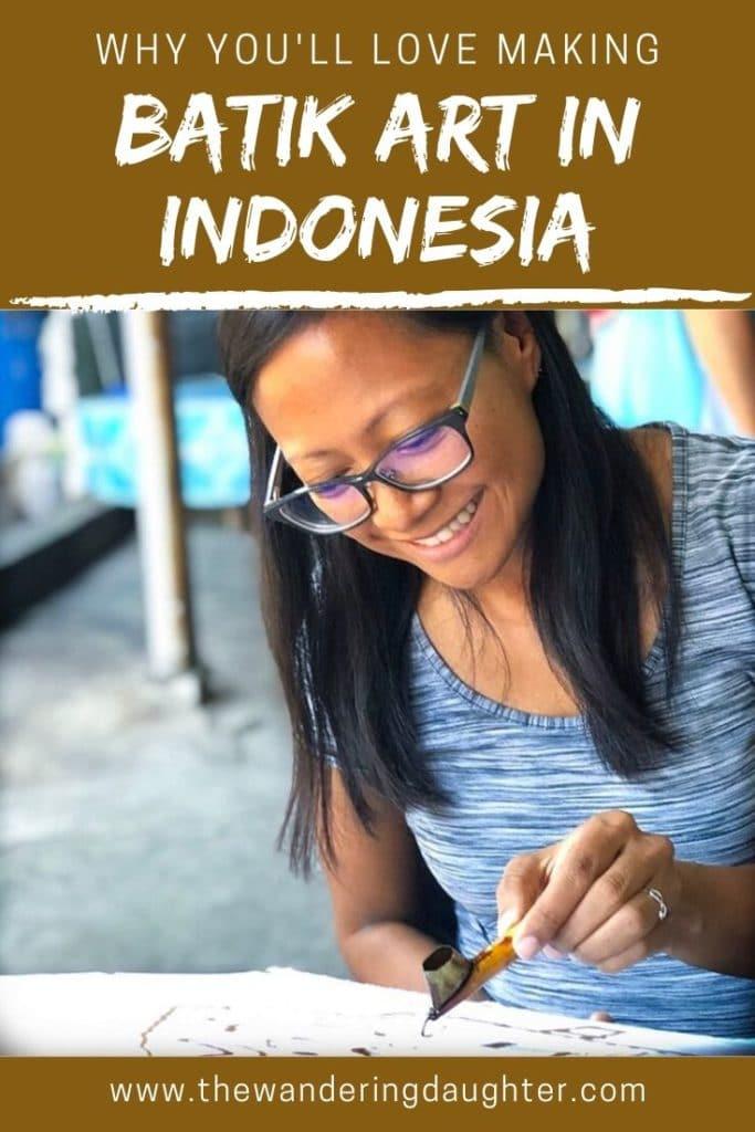 Why You'll Love Making Batik Art in Yogyakarta, Indonesia   The Wandering Daughter   Why families traveling to Yogyakarta, Indonesia will enjoy making batik art. Pinterest image of a woman printing a wax design for batik.