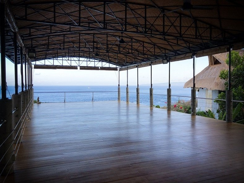 A yoga space over looking the ocean in Bali, Indonesia, for reflection while raising kids to be an avid traveller