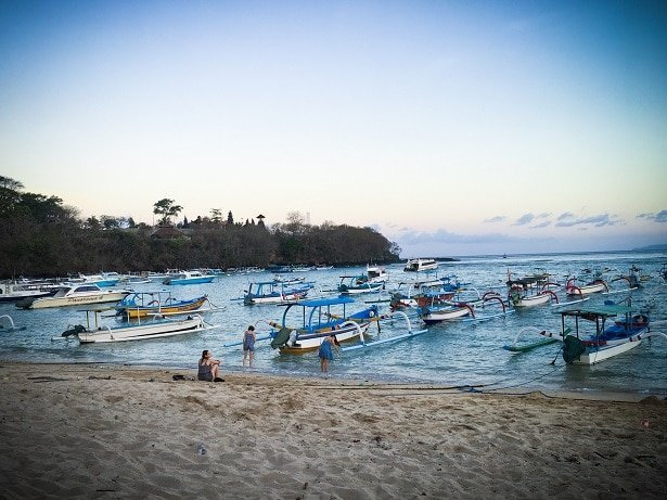 Traditional fishing boats on the water near a beach in Padang Bai in Indonesia, where travelers can visit during a 10 day Bali itinerary