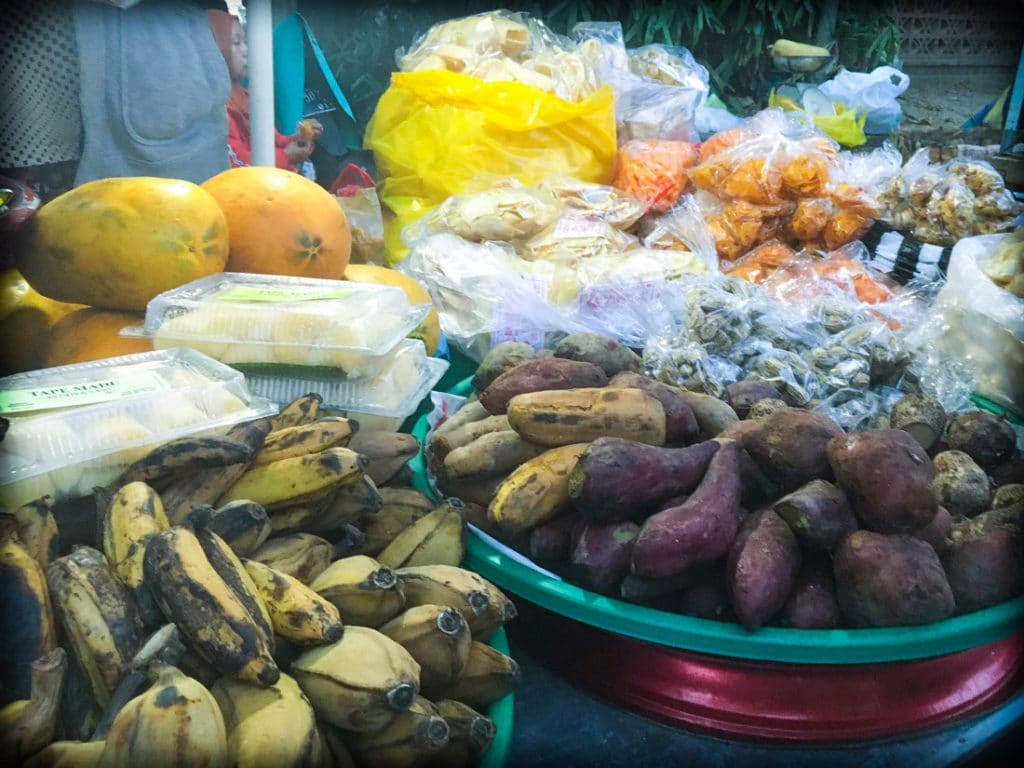 Bananas, sweet potatoes, melons, and starchy snacks sold at a Bali night market in Gianyar, Indonesia