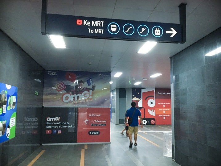 A man walking through an MRT station in Jakarta, Indonesia, visiting attractions in Jakarta