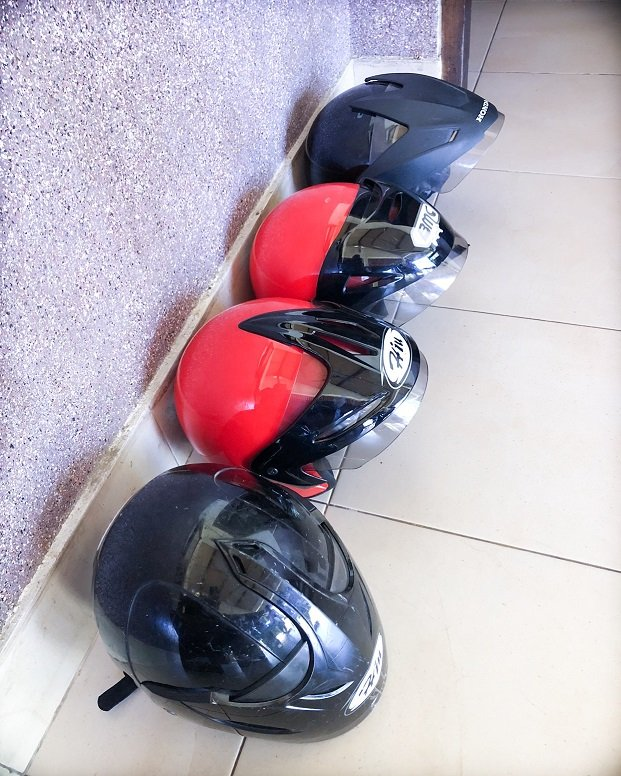 Black and red scooter helmets for use during a scooter rental in Bali and Lombok