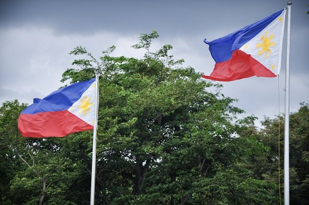 Flags in the Philippines, where families can adjust to jet lag for a toddler