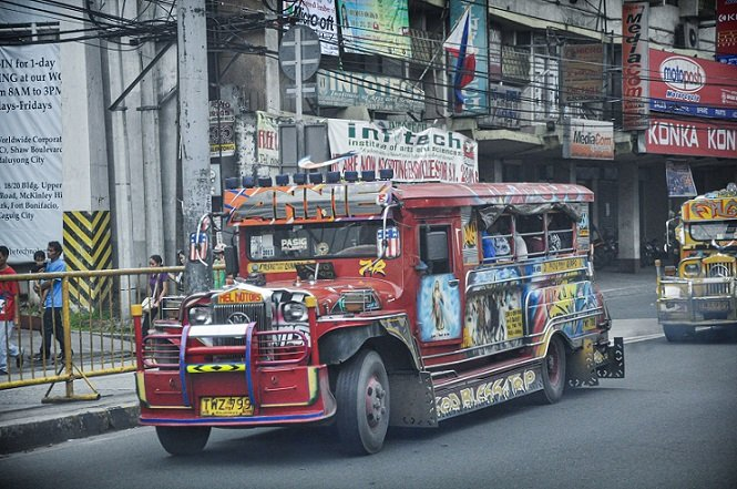 A jeepney on the street in Manila, transportation for one day in Manila