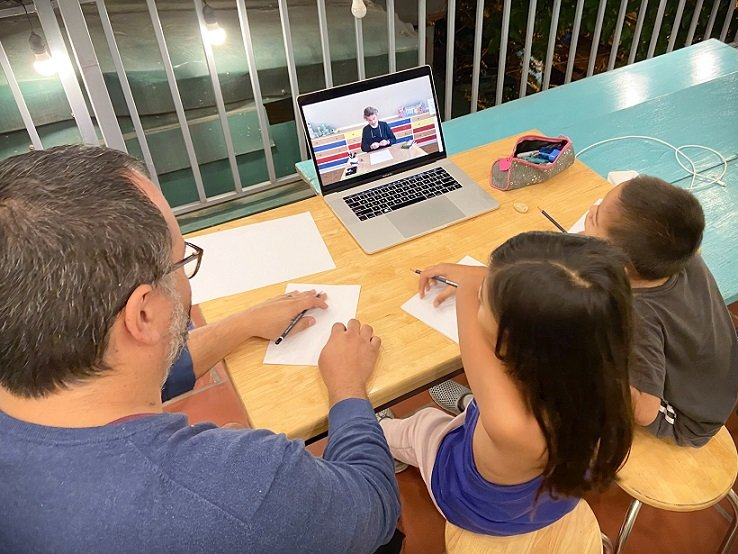 A worldschooling family learning how to draw using an online class