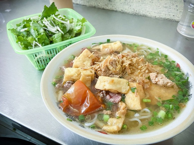 A bowl of bun rieu cua, food in Hanoi made of crab soup