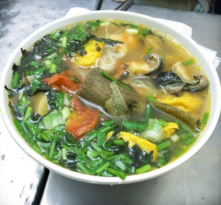 A bowl of snail soup called bun oc, a popular food in Hanoi