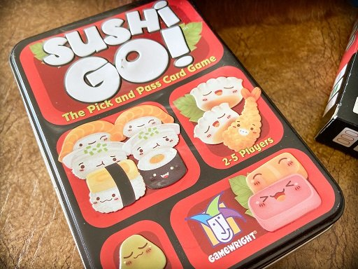 Travel card games for families: Sushi Go!