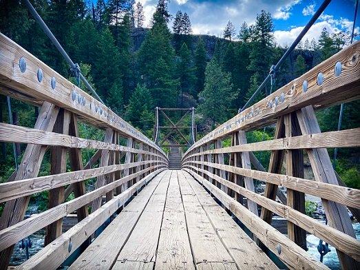 Swinging bridge for hiking in Spokane at Bowl and Pitcher, Riverside State Park in Washington