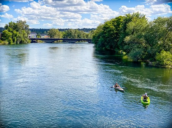 Kayakers on the Spokane River near the Centennial Trail where visitors can go hiking in Spokane