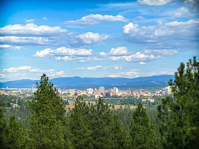 A semi-aerial view of downtown Spokane from Palisades Park while hiking in Spokane
